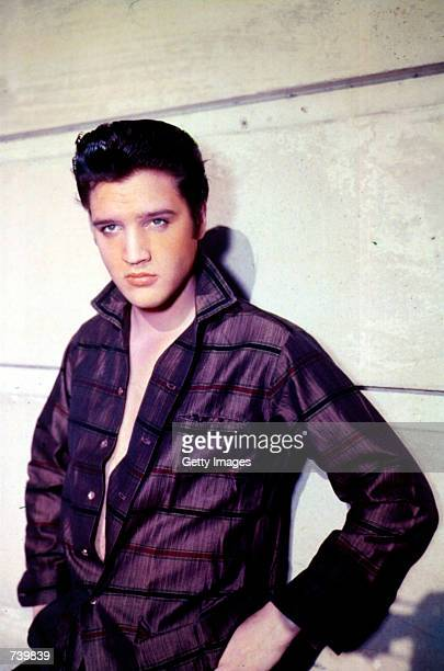 Singer Elvis Presley poses for a studio portrait.