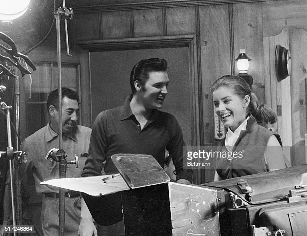 Singer Elvis Presley, , shown here at a recording session with actress Dolores Hart, plays the part of a small town boy who becomes a sudden singing...