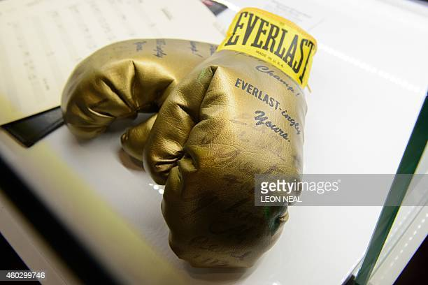 US singer Elvis Presley's boxing gloves signed by boxer Muhammad Ali are displayed during a photocall for the Elvis at the O2 exhibition in London on...