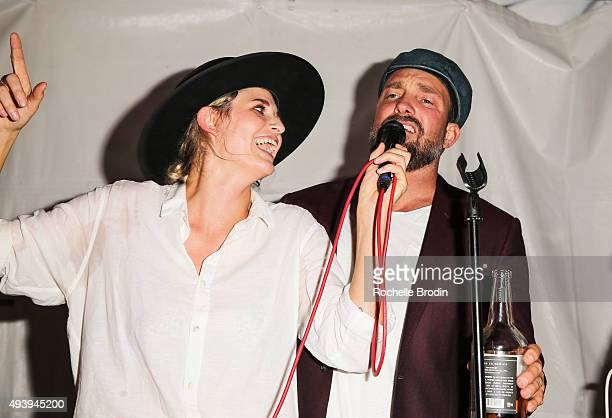 Singer Emily Armstrong of Dead Sara and photographer Brian Bowen Smith sing on stage at 'Metallic Life' by Brian Bowen Smith brought to you by...