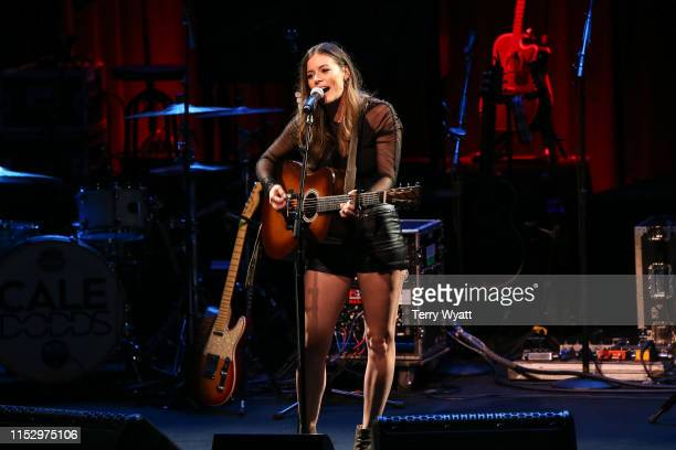 Singer Emily Earle performs during the Musicians On Call 20th Anniversary Kickoff Celebration Presented by Pepsi at CMA Theater at the Country Music...