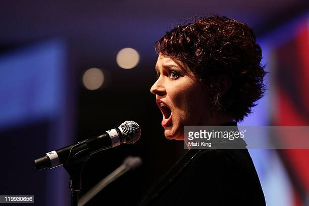 Singer Emma Matthews sings the national anthem during the Australian Olympic Committee Black Tie Dinner at the Sydney Convention Exhibition Centre on...