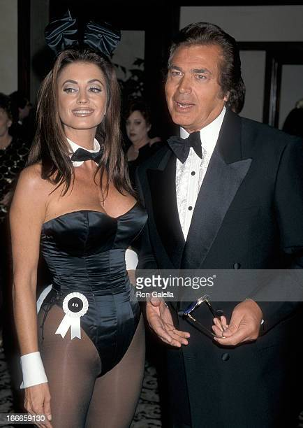 Singer Engelbert Humperdinck and Playboy Bunny attend the Friars' Club of California Lifetime Achievement Award Salute to Hugh Hefner on October 9...