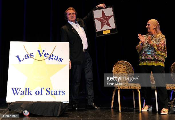 Singer Engelbert Humperdinck holds a small version of his star at the Paris Las Vegas during his Las Vegas Walk of Stars dedication ceremony as his...