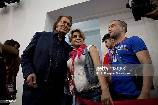 Singer Engelbert Humperdinck of United Kingdom takes photos with fans after a press conference at Cristal Hall during the lead up to the Eurovision...