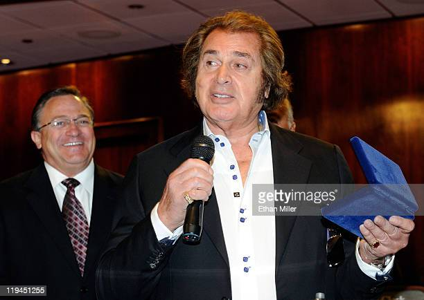 Singer Engelbert Humperdinck speaks after being presented with a ceremonial key to the city as Las Vegas City Councilman Steve Ross looks on at Las...