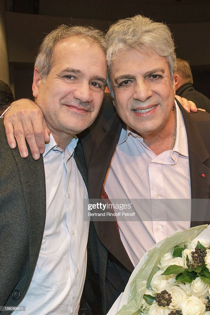 Singer Enrico Macias (R) and director Antoine Casubolo Ferro pose as they attend the screening of 'Enrico Macias, la vie en chansons' (Enrico Macias, life in songs), a documentary by Casubolo Ferro, at SACEM on January 10, 2013 in Neuilly-sur-Seine, France.