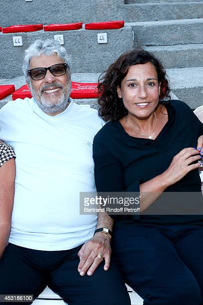 Singer Enrico Macias and his daughter Jocya Ghrenassia attend the 30th Ramatuelle Festival Day 4 on August 4 2014 in Ramatuelle France