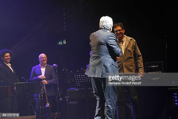 """Singer Enrico Macias and his Son Jean-Claude Ghrenassia perform during """"Enrico Macias Show"""" at L'Olympia on January 08, 2017 in Paris, France."""