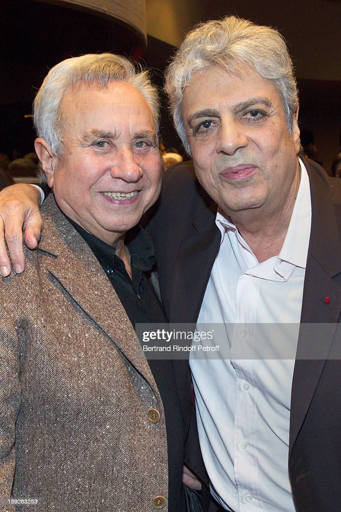 Singer Enrico Macias (R) and Philippe Clerc attend the screening of 'Enrico Macias, la vie en chansons' (Enrico Macias, life in songs), a documentary by Antoine Casubolo Ferro, at SACEM on January 10, 2013 in Neuilly-sur-Seine, France.