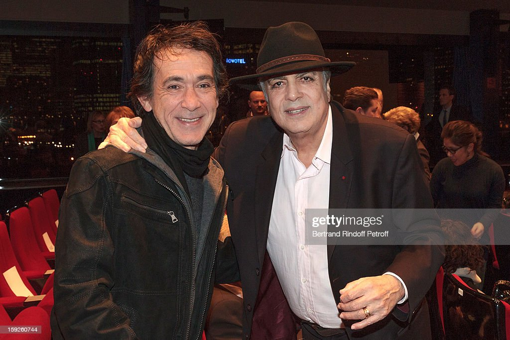 Singer Enrico Macias (R) and songwriter Marc Esteve attend the screening of 'Enrico Macias, la vie en chansons' (Enrico Macias, life in songs), a documentary by Antoine Casubolo Ferro, at SACEM on January 10, 2013 in Neuilly-sur-Seine, France.
