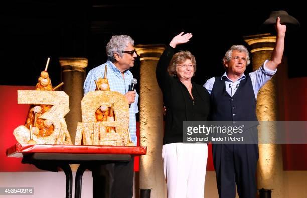 Singer Enrico Macias President of Ramatuelle Festival Jacqueline Franjou and Artistic Director of the Festival Michel Boujenah pose near a Birthday...