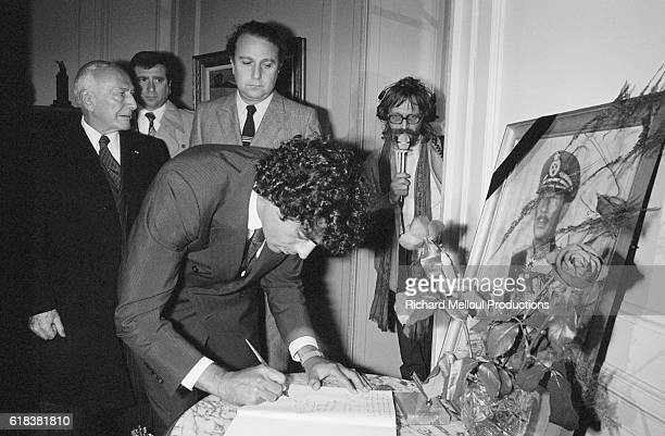 Singer Enrico Macias signs a memorial book at a service held in Paris for Egyptian president Anwar el-Sadat, who was assassinated October 6 while...