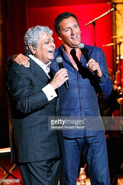 Singer Enrico Macias singing with Dani Brillant as he gives a concert at the 30th Ramatuelle Festival Day 10 on August 10 2014 in Ramatuelle France