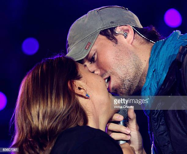 Singer Enrique Iglesias kisses a fan on stage during Los 40 Principales concert at the Estadio Azteca on November 6 2008 in Mexico City