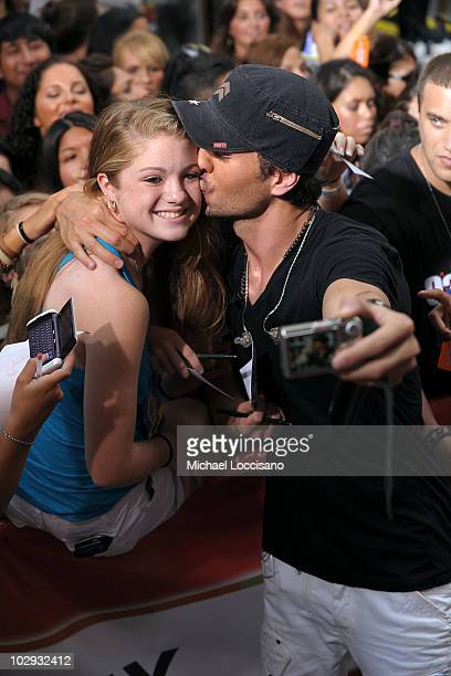 Singer Enrique Iglesias kisses fan Nicolette Benderoth during his performance on NBC's 'Today' at Rockefeller Center on July 16 2010 in New York City