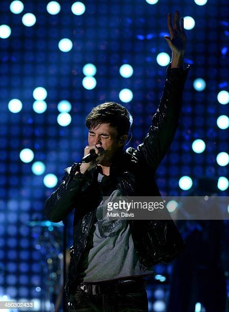 Singer Enrique Iglesias performs onstage during the 5th Annual TeenNick HALO Awards at Hollywood Palladium on November 17 2013 in Hollywood California
