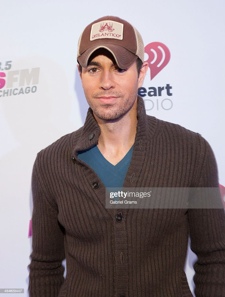 Singer Enrique Iglesias poses in the press room at 103.5 KISS FM's Jingle Ball 2013 at United Center on December 9, 2013 in Chicago, Illinois.