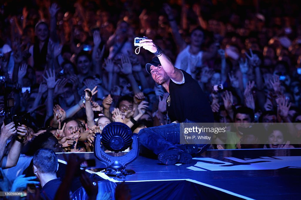 Singer Enrique Iglesias takes a photograph for a fan on stage during MTV Live Georgia at Europe Square on August 2, 2011 in Batumi, Georgia.