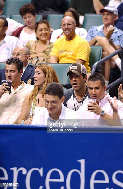 Singer Enrique Iglesias watches from the stands as Anna Kournikova plays in the 2005 MercedesBenz Classic at The Office Depot Center May 21 2005 in...