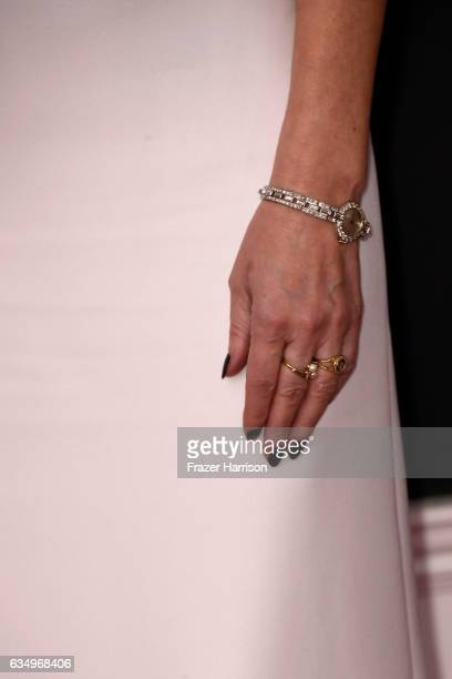 Singer Enya, jewelry detail, attends The 59th GRAMMY Awards at STAPLES Center on February 12, 2017 in Los Angeles, California.