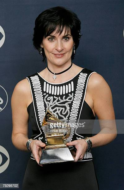 Singer Enya poses in the press room with her Grammy for Best New Age Album Amarantine at the 49th Annual Grammy Awards at the Staples Center on...