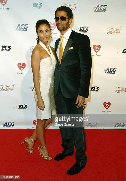 Singer Eric Benet and Manuela Testolini arrive at the 2009 MusiCares Person of the Year Tribute to Neil Diamond at the Los Angeles Convention Center...
