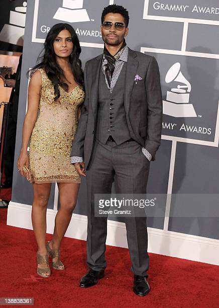 Singer Eric Benet and Manuela Testolini arrive at The 54th Annual GRAMMY Awards at Staples Center on February 12 2012 in Los Angeles California