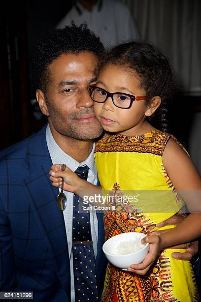 Singer Eric Benet shares a tender moment with his daughter Lucia Bella Benet at the 'In A Perfect World Give 100 Fundraiser' at The District...