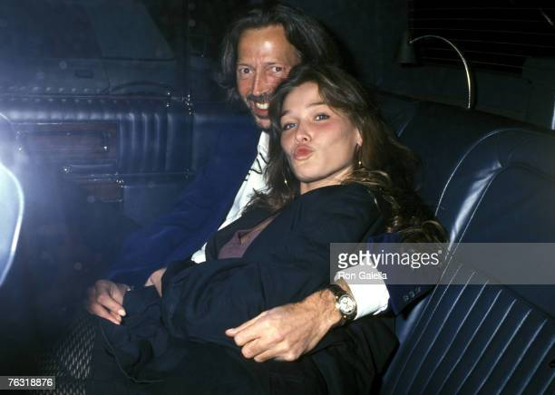 Singer Eric Clapton and model Carla Bruni arrive at Bill Wyman's Birthday Party on October 24 1989 at Red Zone in New York City New York