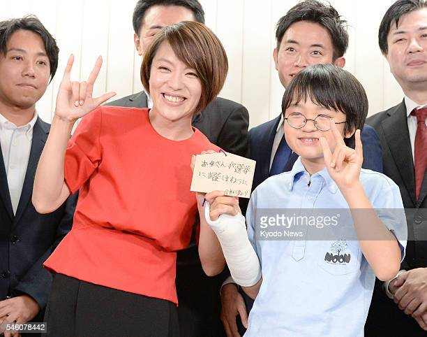 Singer Eriko Imai poses for a photo with her son Raimu in Tokyo after winning a seat on the proportional representation list of the ruling Liberal...