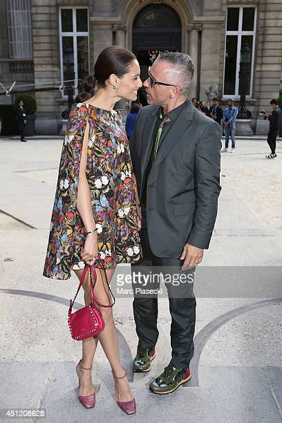 Singer Eros Ramazzotti and wife Marica Pellegrinelli arrive to attend the 'Valentino' Menswear Spring/Summer 2015 on June 25 2014 in Paris France