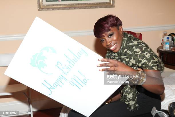 Singer Estelle signs the Mohammed Al Turki birthday card at Moet House on July 3, 2011 in Southampton, New York.