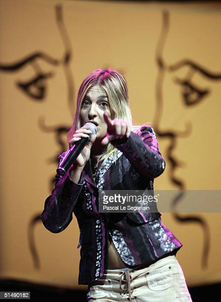 """Singer Eve Angeli performs at the second day of the """"Fight Aids Monaco"""" concert on October 17, 2004 in Avignon, France. Princess Stephanie of Monaco..."""