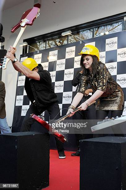 Singer 'Evil' Jared Hennagan and Amy Macdonald smash a guitar attend the reopening of the Hard Rock Cafe on April 28 2010 in Berlin Germany