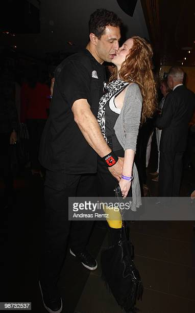Singer 'Evil' Jared Hennagan and partner SinaValeska Jung attend the Hard Rock Cafe Berlin reopening on April 28 2010 in Berlin Germany