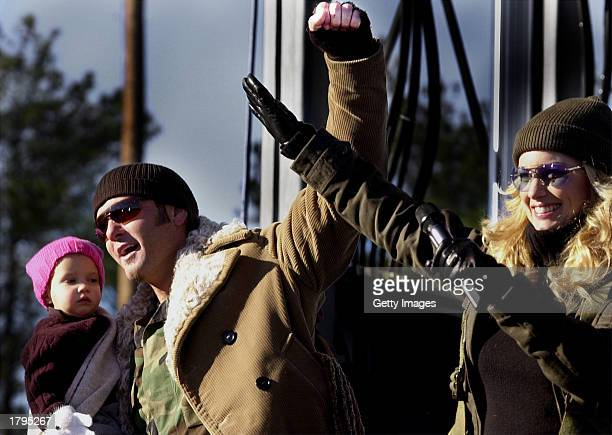 Singer Faith Hill and husband Tim McGraw wave to troops February 13 2003 at Fort Bragg in North Carolina Hill sang for a largely military crowd at...