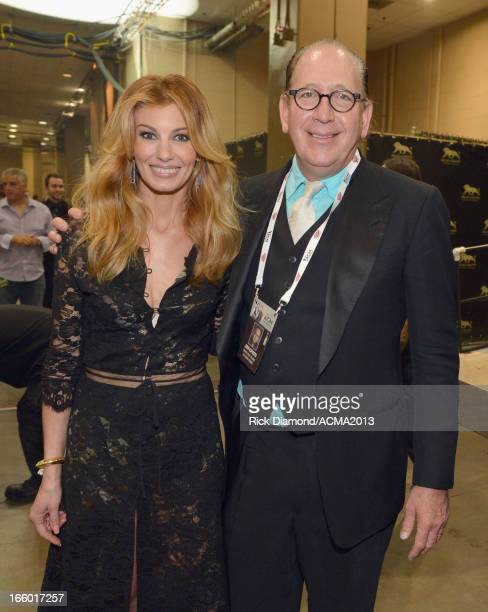 Singer Faith Hill and President of Warner Music Nashville John Esposito attend the 48th Annual Academy of Country Music Awards at the MGM Grand...