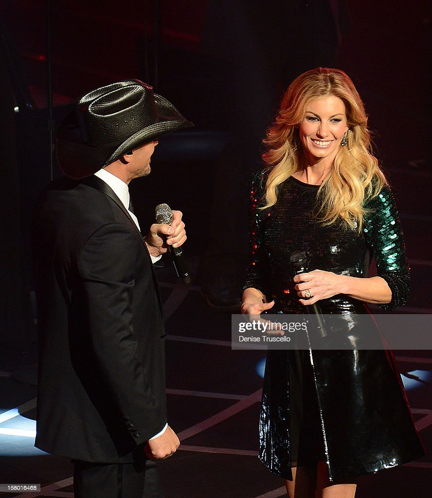 Singer Faith Hill (R) and singer/songwriter Tim McGraw perform during the opening weekend of their limited-engagement 'Soul2Soul' show at The Venetian on December 8, 2012 in Las Vegas, Nevada. The country music couple is scheduled to perform on 10 weekends through April 2013.