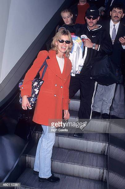 Singer Faith Hill, singer Tim McGraw and daughter Gracie McGraw arrive from Nashville, Tennessee on November 17, 1997 at the Los Angeles...