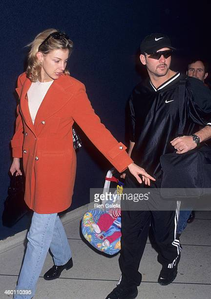 Singer Faith Hill singer Tim McGraw and daughter Gracie McGraw arrive from Nashville Tennessee on November 17 1997 at the Los Angeles International...