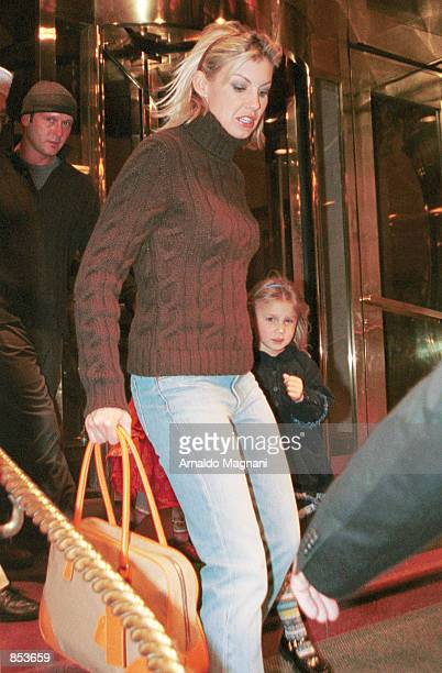Singer Faith Hill Tim McGraw and daughter Gracie Katherine head out for the night March 30 2001 from a midtown hotel in New York City
