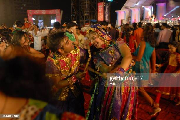 Singer Falguni Pathak performing while Young girls and women playing dandiya at Goregaon during the Navratri festival