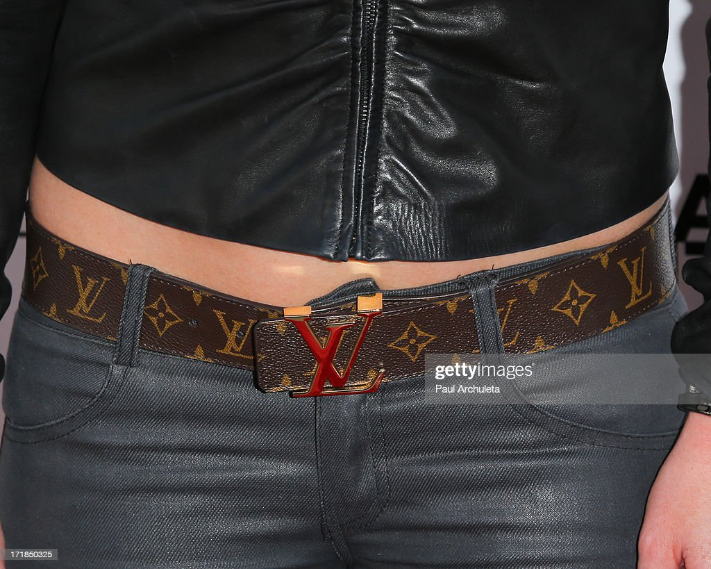 Singer / Fashion Designer Nikki Lund (belt detail) attends the Genlux Magazine summer issue release party at the Luxe Rodeo Drive Hotel on June 28, 2013 in Beverly Hills, California.