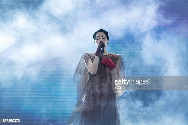 Singer Faye Wong performs onstage during her concert Faye's Moments Live 2016 at Shanghai MercedesBenz Arena in December 30 2016 in Shanghai China