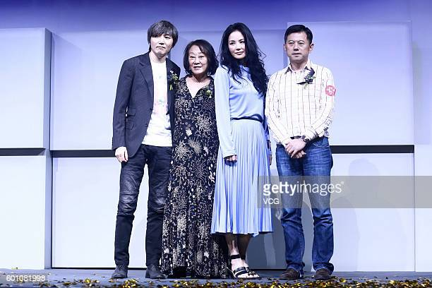 Singer Faye Wong poses with her agent Katie Chan and musician Wang Yadong on a press conference for her concert on September 9 2016 in Beijing China