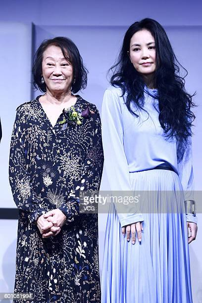 Singer Faye Wong poses with her agent Katie Chan on a press conference for her concert on September 9 2016 in Beijing China