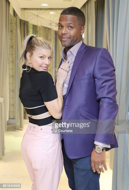 Singer Fergie and A J Calloway pose for a photo during Fergie's visit to 'Extra' at their New York Studios at HM Times Square on September 22 2017 in...