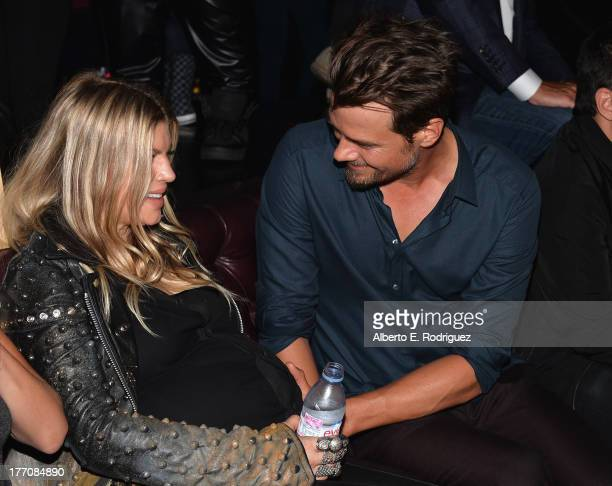 Singer Fergie and actor Josh Duhamel attend the after party for the premiere of Vertical Entertainment's 'Scenic Route' at Beacher's Madhouse in the...