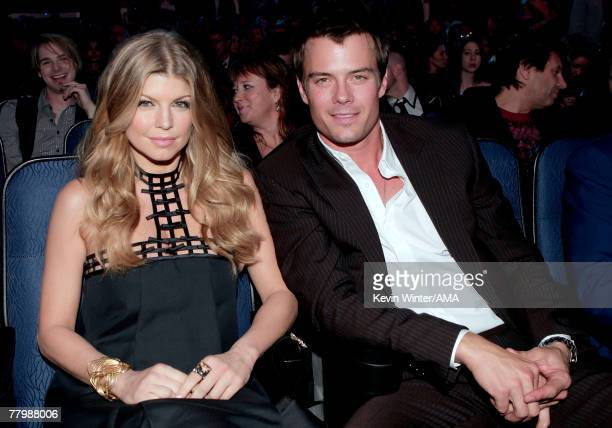 Singer Fergie and Actor Josh Duhamel in the audience during the 2007 American Music Awards held at the Nokia Theatre LA LIVE on November 18 2007 in...